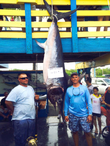 Capt. Rick (right) with a record-breaking 480.9 lb. swordfish caught on THE SEA HORSE.